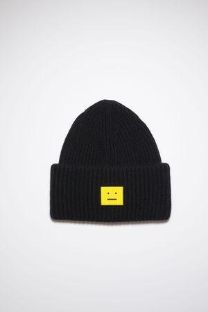 Acne Studios  FA-UX-HATS000103 Schwarz/Gelb  Beanie mit Face-Logo
