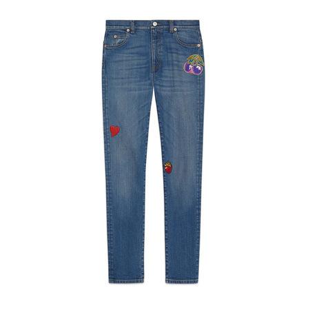 Gucci Eng anliegende Hose aus Denim mit Patches grau