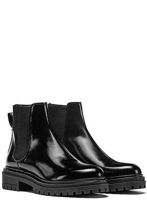 HUGO BOSS Chelsea Boots aus gebürstetem Leder mit Profilsohle schwarz