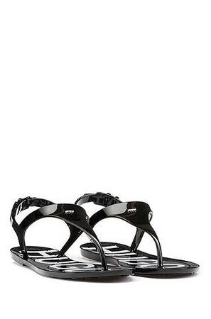HUGO BOSS Glänzende Zehensandalen mit Logo am Fußbett grau