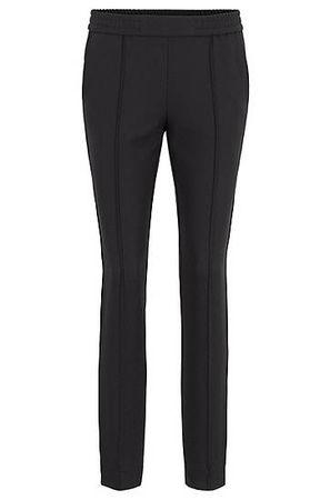 HUGO BOSS Relaxed-Fit Hose aus Stretch-Krepp mit seitlichem Tape schwarz
