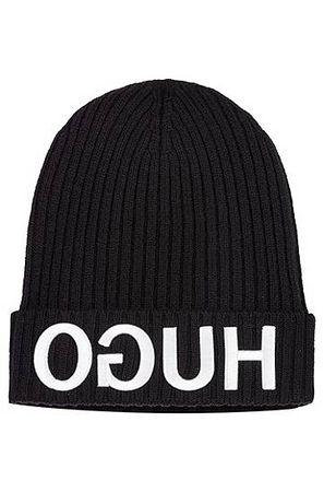 HUGO BOSS Wollmütze mit Reversed-Logo in 3D-Optik schwarz